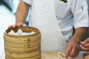 Person making dimsum