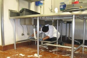 A man cleaning the kitchen